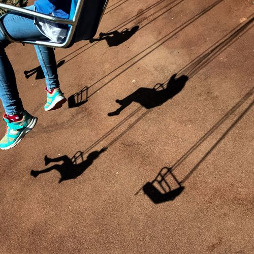 Flying again 😀 Parc Asterix - Paris - France Eyeemphotography Moment Shadow Flying Chair Paris Parc Asterix Low Section Human Leg Shadow Human Body Part Body Part Sunlight High Angle View Shoe Day Leisure Activity Outdoors