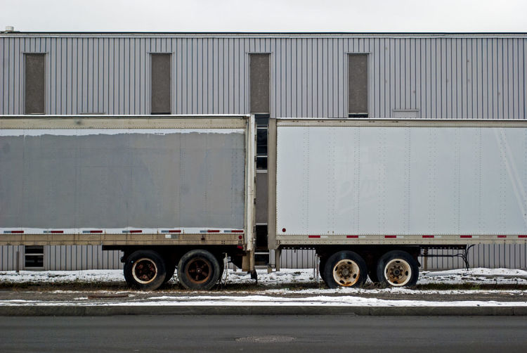 Building Day Full Frame Geometry Land Vehicle No People Pattern Rectangle Repetition Road Rusty Side By Side Sidewalk Snow Symmetry Trailer Transportation Truck Winter
