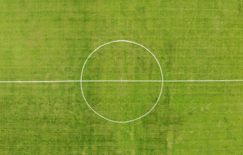 A soccer field Grass Green Color Sport Plant Geometric Shape Circle Soccer Field Nature Shape Day Soccer No People Outdoors Playing Field Sports Equipment Team Sport High Angle View White Color Field