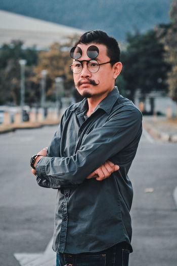 Man wearing eyewear while standing in city