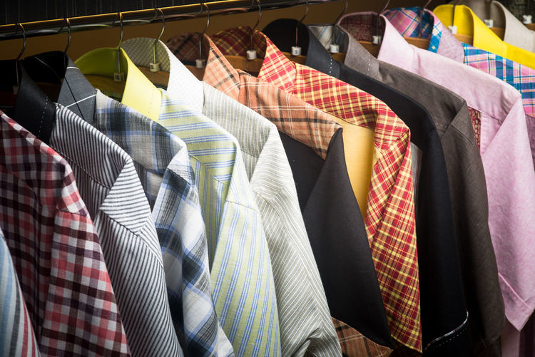 Arrangement Business Button Down Shirt Choice Clothing Coathanger Consumerism Fashion For Sale Garment Hanging In A Row Large Group Of Objects Menswear Multi Colored No People Order Rack Retail  Retail Display Sale Shopping Store Textile Variation