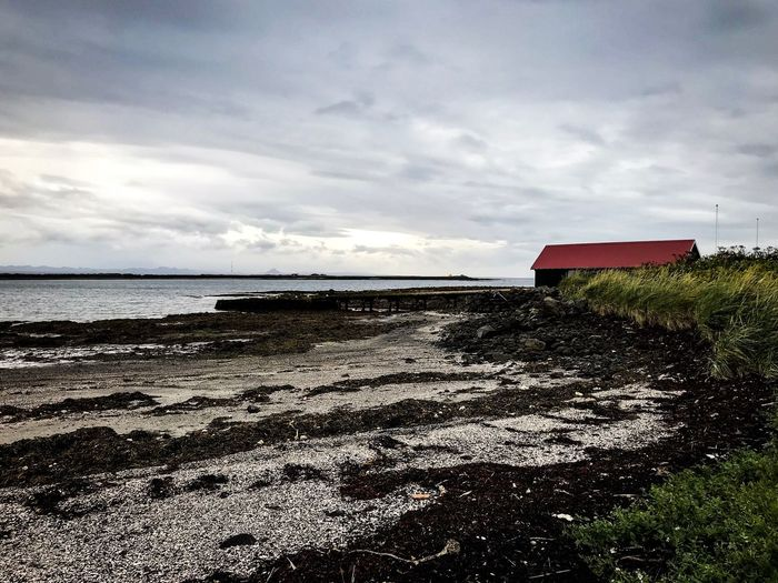 Minimalism Lighthouse Natgeo Iceland Sky Cloud - Sky Water Land Built Structure Beach Sea Architecture No People Tranquility House Beauty In Nature