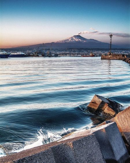 Sicily is living poetry Water Sunset Sky Sea No People Outdoors Nature Snow Beauty In Nature Day Mountain Mountains Etna Volcano City Travel Photography Sicily Nature The City Light