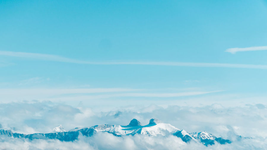 Sky Cloud - Sky Beauty In Nature Scenics - Nature Blue Tranquility Tranquil Scene Nature Day No People Idyllic Outdoors Cold Temperature Environment Winter White Color Copy Space Cloudscape Landscape Non-urban Scene Mountain Peak
