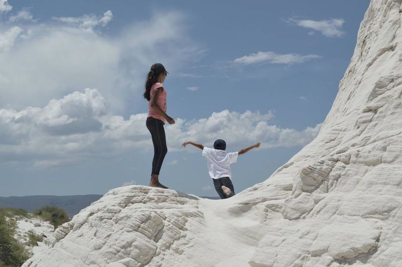 Togetherness Cloud - Sky Sky Day Full Length Family With One Child Men Nature Adult Women Outdoors Love Mountain Leisure Activity Low Angle View Vacations Bonding Standing Young Women Young Adult