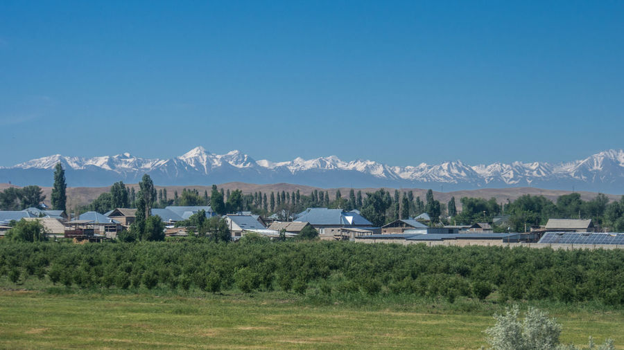 View of the mountains of Kyrgyzstan, as seen from the Almaty-Aktau railway in the Kazakhstan steppe Landscape Mountain Mountain Range No People Scenics - Nature Snowcapped Mountain Steppe Tranquil Scene
