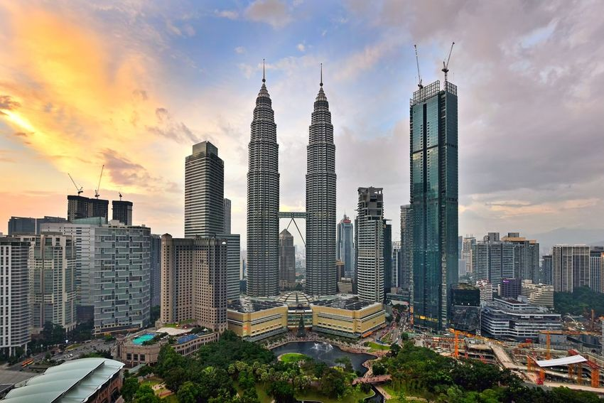 Kuala Lumpur cityscape during sunset Klcc Kuala Lumpur Aerial Photography Skyline Landscape Travel Destinations Travel Holiday Sunset_collection Sky And Clouds Malaysia Getty Images EyeEm Selects EyeEm Best Shots City Cityscape Urban Skyline Modern Skyscraper Illuminated Sunset Downtown District Business Finance And Industry Office Building Exterior Office Building Dramatic Sky Tower Construction Architectural Design Financial District