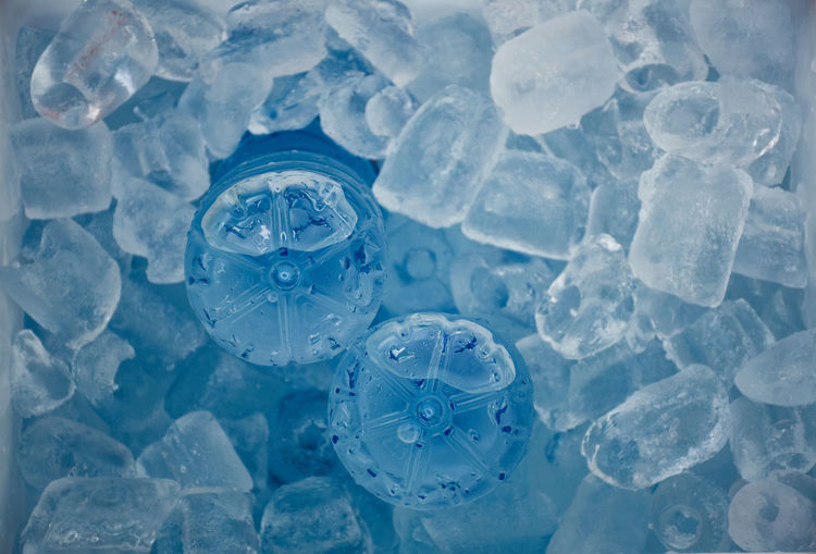 Close up of ice cubes and water bottles getting cool in picnic cooler box. Concept of Holiday, vacations and refreshing. Ice cubes texture and background. Blue Cold Temperature Frozen Ice No People Close-up Nature Full Frame Backgrounds Bar Refreshment Refreshing Drink Water Bottles Getting Creative Advertisement Ice Cube Freshness Cooler Camping Textured  Frost Party Macro Design