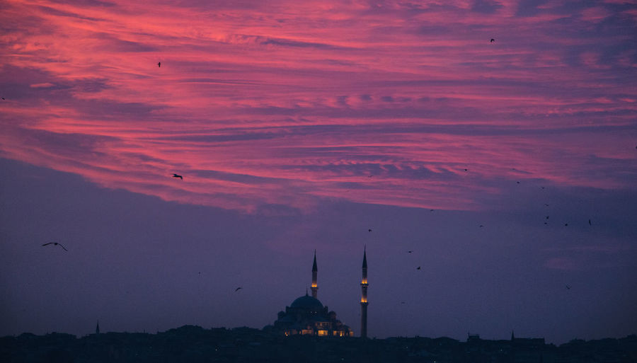 Silhouette Mosque Against Cloudy Sky During Sunset