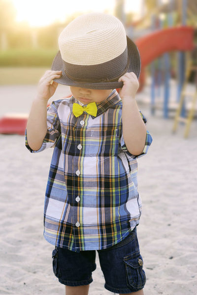 Bowtie Boy Boys Casual Clothing Childhood Day Elementary Age Focus On Foreground Hat Hat Kid Wearing Kids Bows Kidsphotography Leisure Activity Lifestyles One Person Outdoors Playground Playground Fun With The Kids Real People Sun Hat Yellow Bow