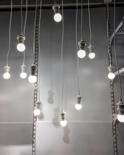 Light Bulb Hanging Lighting Equipment Electricity  Illuminated Electric Light Ceiling In A Row Electric Lamp Bulb Filament Cable Low Angle View Indoors  Technology Glowing No People Connection Lantern Close-up