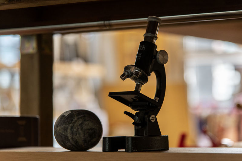 Close-Up Of Microscope On Table