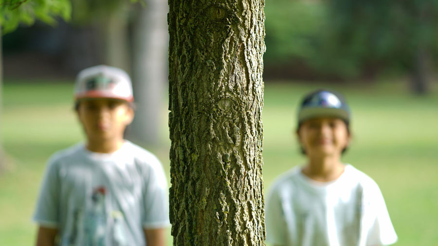 Focus on foreground! Tree trunk! Bokeh Bokeh Photography Casual Clothing Check This Out Day Focus On Foreground Headshot Kids Kids Photography Lifestyles Nature Outdoors Selective Focus Toronto Torontophotographer Tree Tree Trunk
