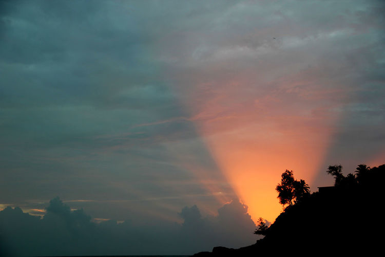Beauty In Nature Cloud - Sky Dramatic Sky Hide And Seek Nature No People Outdoors Scenics Silhouette Storm Cloud Sunset Surface Level Tourchlight Tranquil Scene Tree