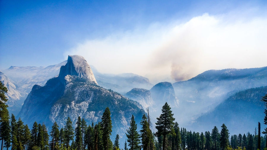 Every year we go on vacation in the summer and wildfires are an unfortunately common aspect of the trip. But even fire can't take away the beauty of Yosemite National Park Yosemite National Park Yosemite Half Dome Beauty In Nature Blue Landscape Mountain Mountain Range Nature No People Outdoors Remote Scenics Smoke The Essence Of Summer Travel Destinations Wildfire National Park Nature's Diversities Glacier Point The Great Outdoors - 2016 EyeEm Awards Feel The Journey Original Experiences California Dreamin
