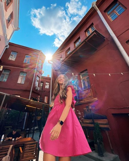 Woman standing amidst buildings in city