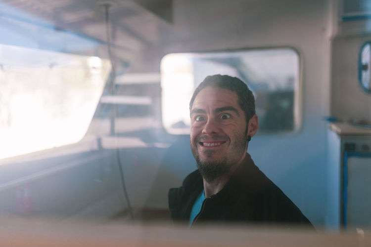 young man playing dumb inside his caravan Portrait Headshot Smiling Transportation Mode Of Transportation One Person Happiness Vehicle Interior Looking At Camera Sitting Car Men Emotion Travel Adult Window Motor Vehicle Males  Indoors  Lens Flare Caravan Restoring Couple Young Adult Update