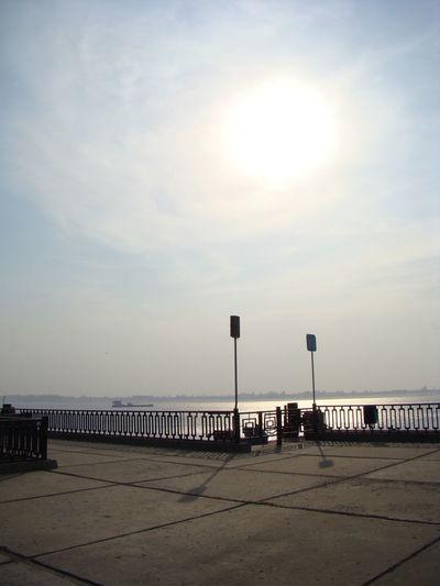 Street by sea against sky