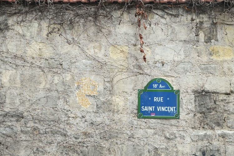 Paris Sign Wall Architecture Built Structure Close-up Communication Day No People Outdoors Text Wall - Building Feature