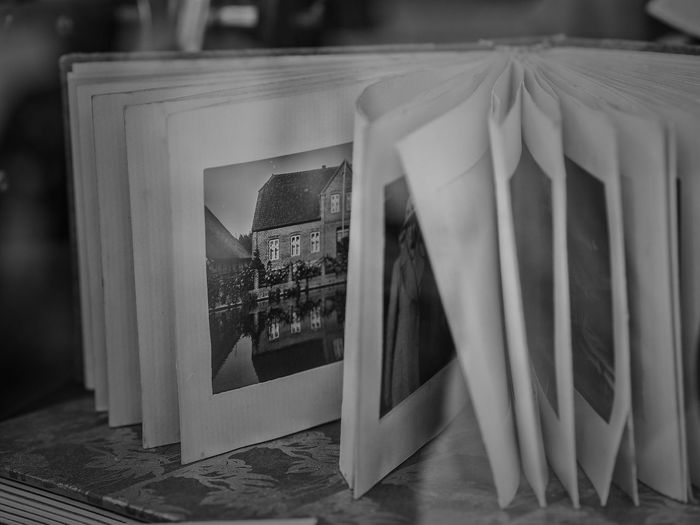 Antiquariat Books Antiquarian Books Arts Culture And Entertainment Box Close-up Container Day Focus On Foreground Glass - Material Historic Photo Indoors  No People Paper Photography Themes Reflection Selective Focus Still Life Table Text Transparent Window View Wood - Material