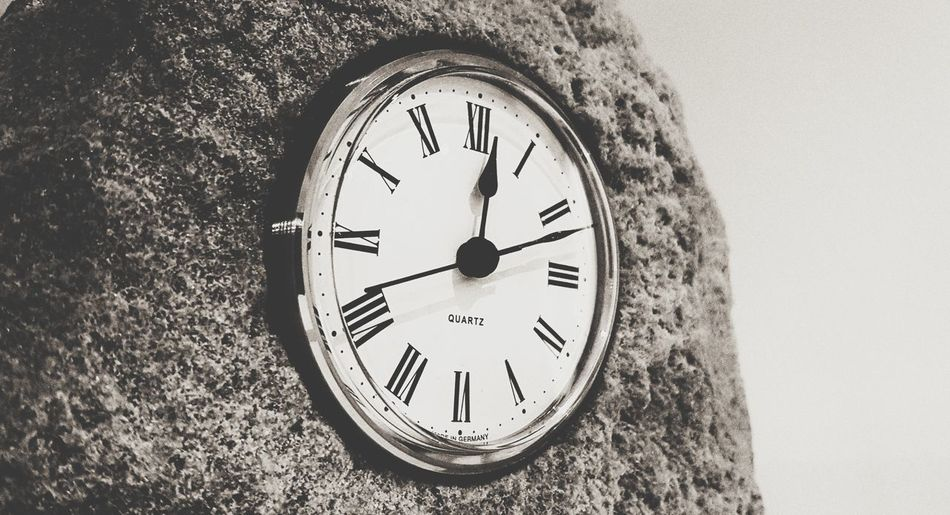 Close-up of clock on wall