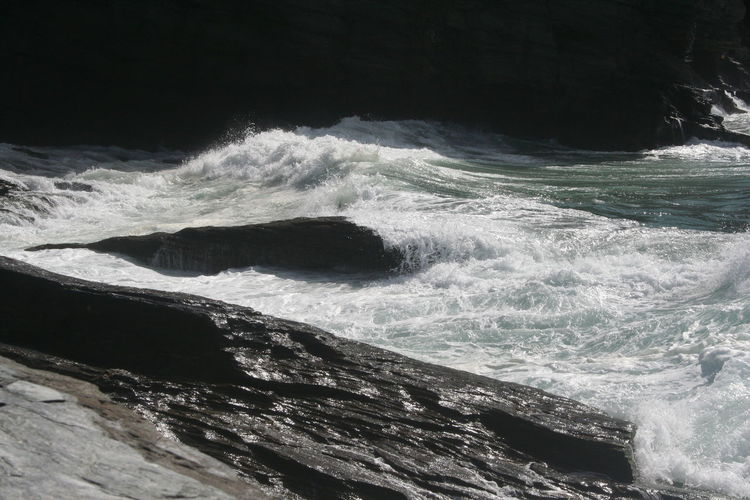 Beauty In Nature Breaking Cornwall Flowing Water High Angle View Idyllic Motion Nature No People Outdoors Power In Nature Rock - Object Rock Formation Scenics Sea Splashing Surf Tre Bar With Strand Water Wave