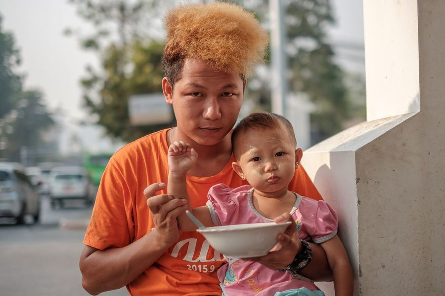 Portrait in the streets of Yangon Myanmar Myanmar Yangon Streetphotography Documentary Storytelling Travel People Child Childhood Family Baby Parent Portrait Real People Togetherness Looking At Camera Innocence