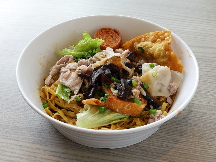 Close-up of bak chor mee in bowl on table
