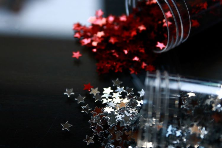 Shiny little stars Still Life Table Glass - Material Red Color Shiny Stars Silver  Focus On Foreground Close-up No People Selective Focus Decoration Indoors  Reflection Christmas
