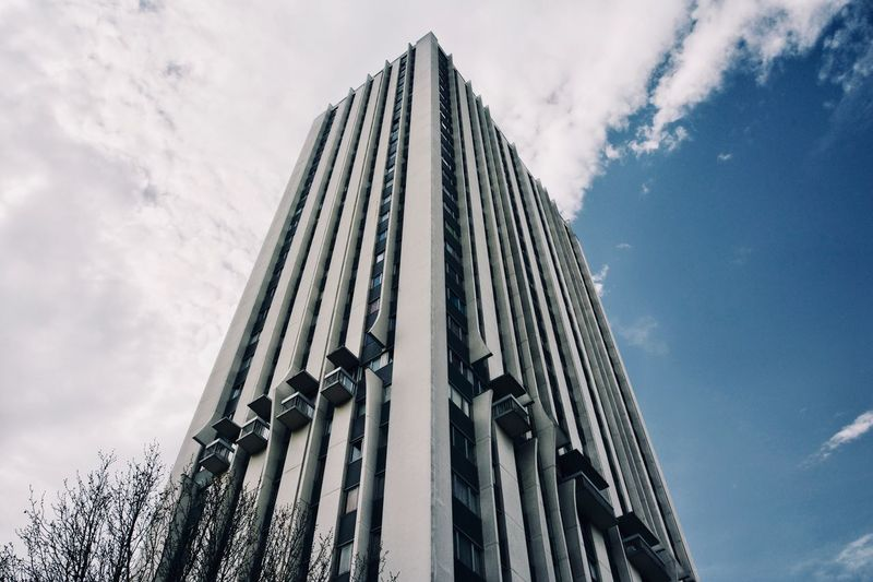 High in the sky🇫🇷 Sky Low Angle View Cloud - Sky Architecture Building Exterior Built Structure Nature No People Building Day Modern City Outdoors Tall - High Pattern Tower Skyscraper