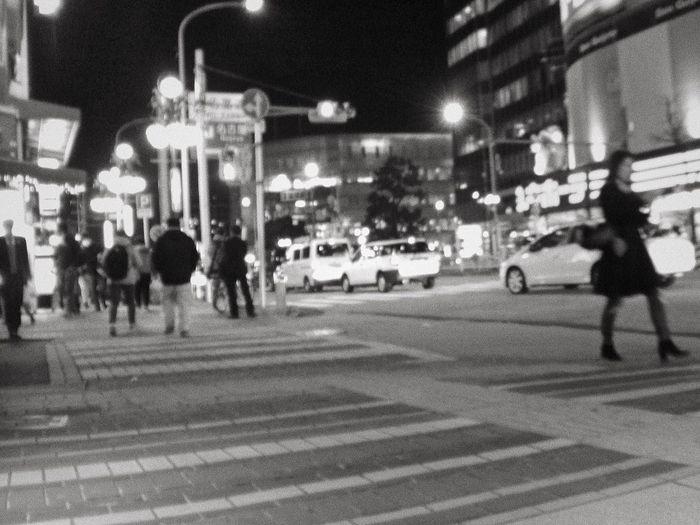 People crossing road at night