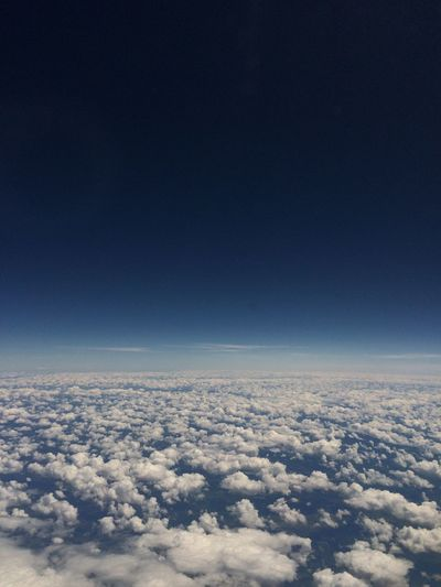 Aerial view of clouds against blue sky