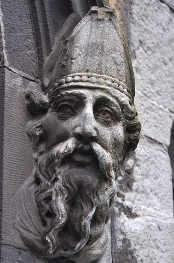 Close-up of statue against wall