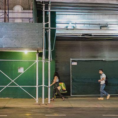 Two people walking on the SidewalkAcross Streetphotography People 50mm NYC urban midtown