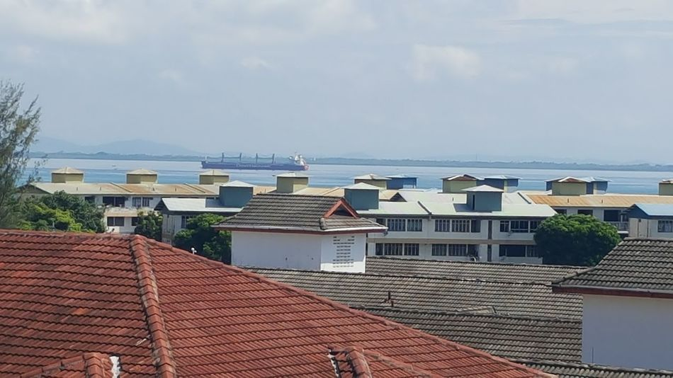 Rooftop View  Blue Sea Calm Sea roofs Sky Day Seaview