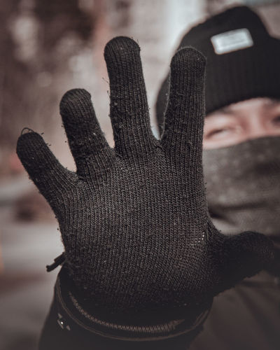 Close-up of person hand during winter