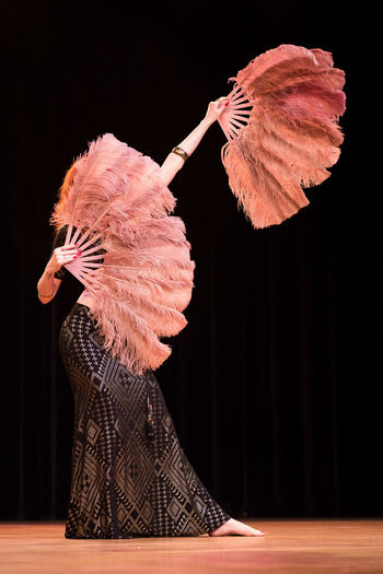 Feathers Adult Arts Culture And Entertainment Beautiful Woman Bellydance Black Background Clothing Costume Dancing Elégance Fashion Hairstyle Indoors  Motion One Person Performance Performing Arts Event Stage Stage - Performance Space Standing Studio Shot Theatrical Performance Women