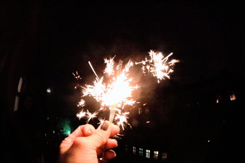 Human Hand Night Real People Lifestyles Holding Event Sparkler Outdoors Celebration Human Body Part Burning Firework - Man Made Object Sparks One Person Flame Motion Close-up Sky Firework