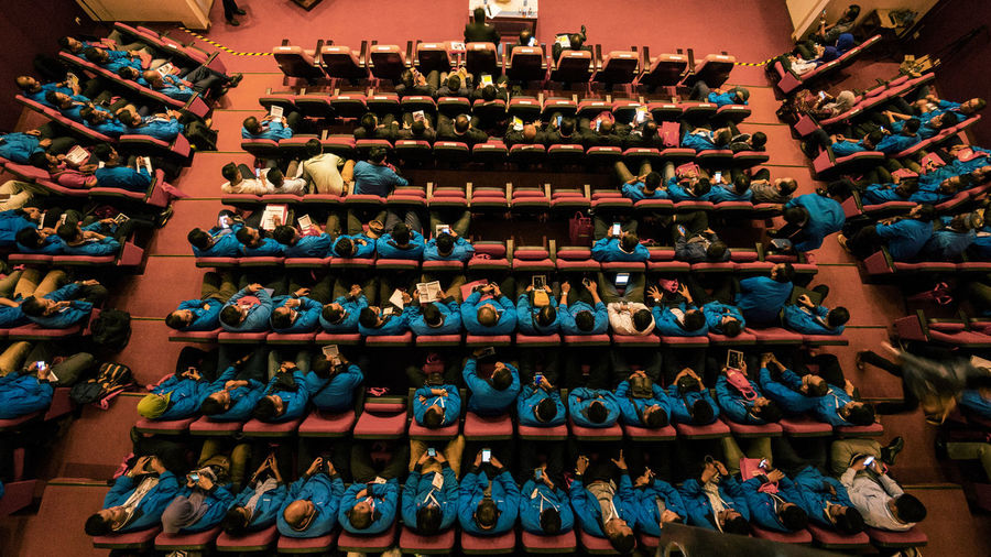 High Angle View Of People Sitting In Auditorium