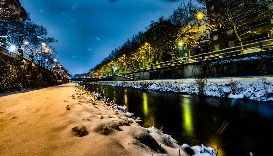 Scenic view of river against sky at night during winter