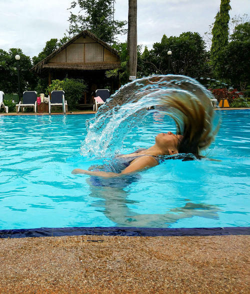 Swimming Pool Water Water Park Fun Leisure Activity Water Slide Wet Splashing Enjoyment Real People Lifestyles Refreshment Day Swimwear Motion Outdoors Shirtless One Person Childhood Swimming Let's Go. Together. Vacations Sommergefühle Travel Close-up