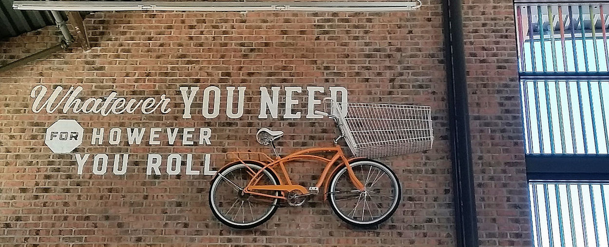 New generation store Bicycle Bike Brick Wall Communication Cycle Exterior Guidance HEB Information Information Sign Light New Generation Store On The Wall Orange Color Retail  San Antonio Texas Sign Stationary Store Supermarket Text Transportation Urban Showcase: January CyclingUnites Lieblingsteil