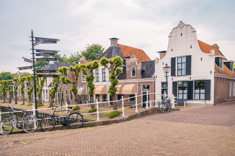 Netherlands Architecture Bicycle Building Building Exterior Built Structure Canal City Cloud - Sky Day Dutch Footpath Freisland Friesland Town House Land Vehicle Mode Of Transportation Nature No People Outdoors Railing Residential District Row House Sky Sloterdijk Street Town Transportation
