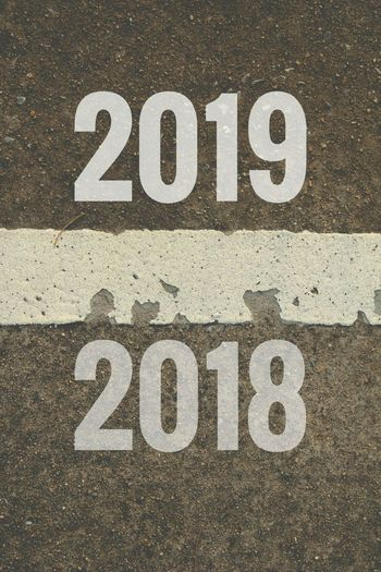 2018 to 2019 line on road. 2018 2019 Road Black New Year LINE Communication Text Close-up Roadways White Line Street Scene Country Road Road Marking Asphalt High Street Empty Road Written Textured