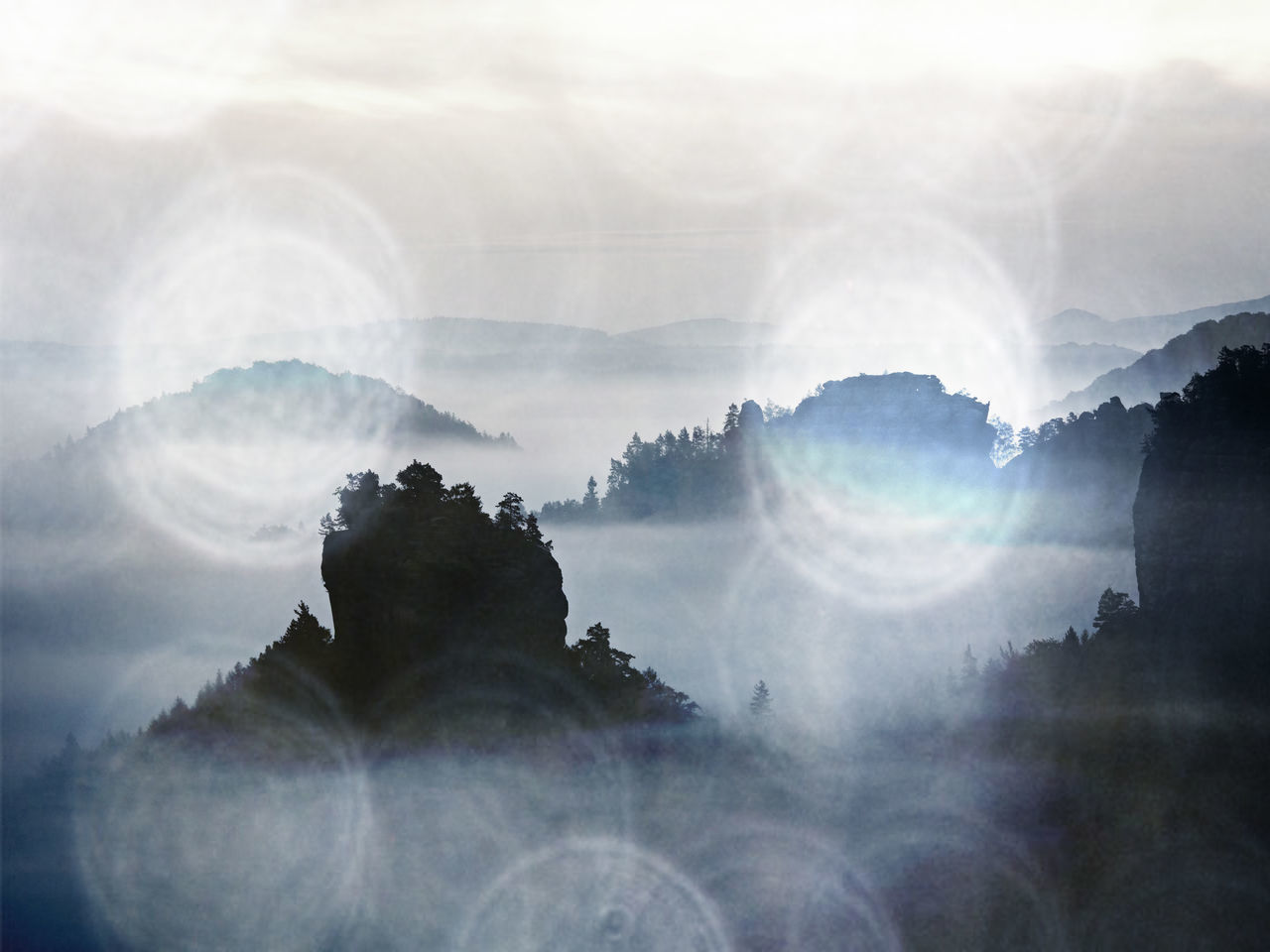 DIGITAL COMPOSITE IMAGE OF MOUNTAIN AND CLOUDS