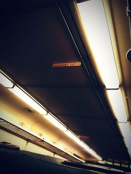 """The Commuter"" Train Interior Eyeem Photography Art, Drawing, Creativity First Eyeem Photo NYC LIFE ♥ The Street Photographer - 2017 EyeEm Awards Dailycommute EyeEmNewHere Trains Art Is Everywhere Travel Morning Commute Rail Transportation Illuminated Emergencyexit New York Penn Station"