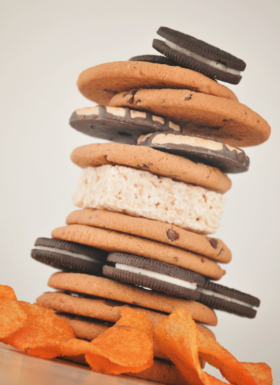 Close-Up Of Stacked Cookies Against White Background