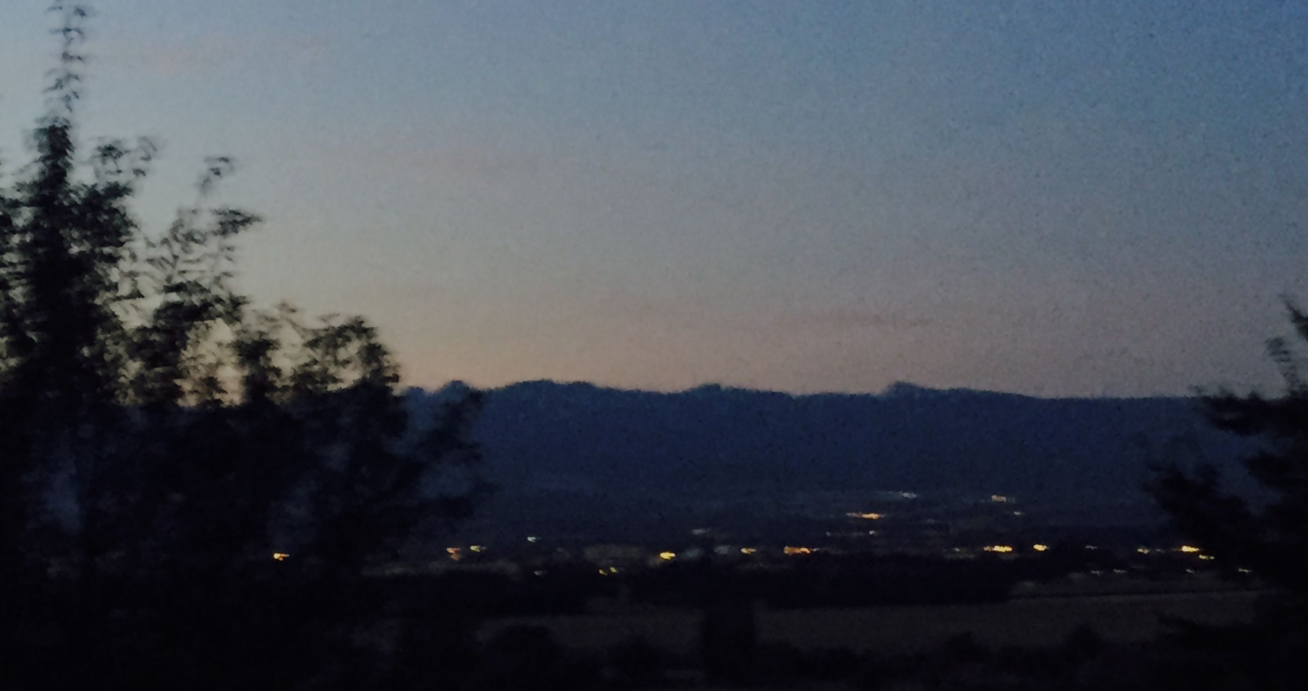 night, illuminated, mountain, dusk, sky, scenics, landscape, tree, beauty in nature, dark, tranquil scene, nature, tranquility, outdoors, mountain range, no people, idyllic, cloud - sky, blue, cloud, weather, growth