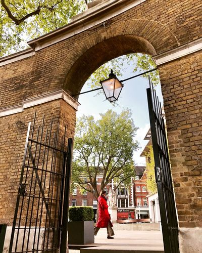 EyeEm LOST IN London Architecture Building Exterior Built Structure One Person Only Women One Woman Only Low Angle View Adult Adults Only Day Red Jacket Outdoors Full Length Travel Destinations Women City London London Lifestyle Adventures In The City