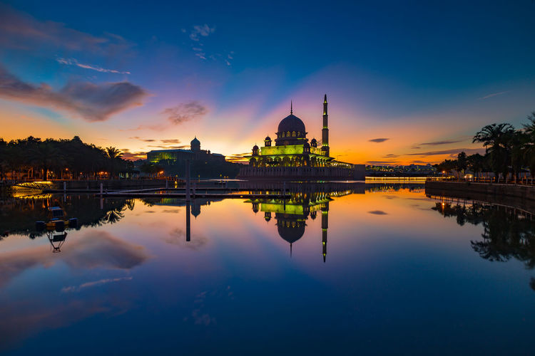 Dramatic Sunrise At Putrajaya Sunrise Silhouette Sunrise_Collection Architecture Beauty In Nature Building Exterior Built Structure Cloud - Sky Day Dome Nature No People Outdoors Place Of Worship Reflecting Pool Reflection Religion Sky Spirituality Sunrise Tourism Travel Destinations Tree Water Waterfront